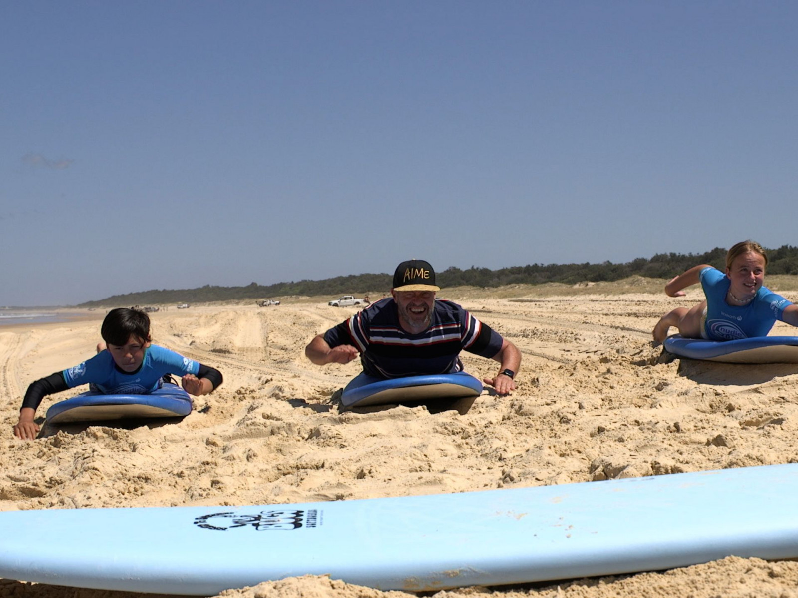 Adam and the kids learning to be pro surfers at South West Rocks