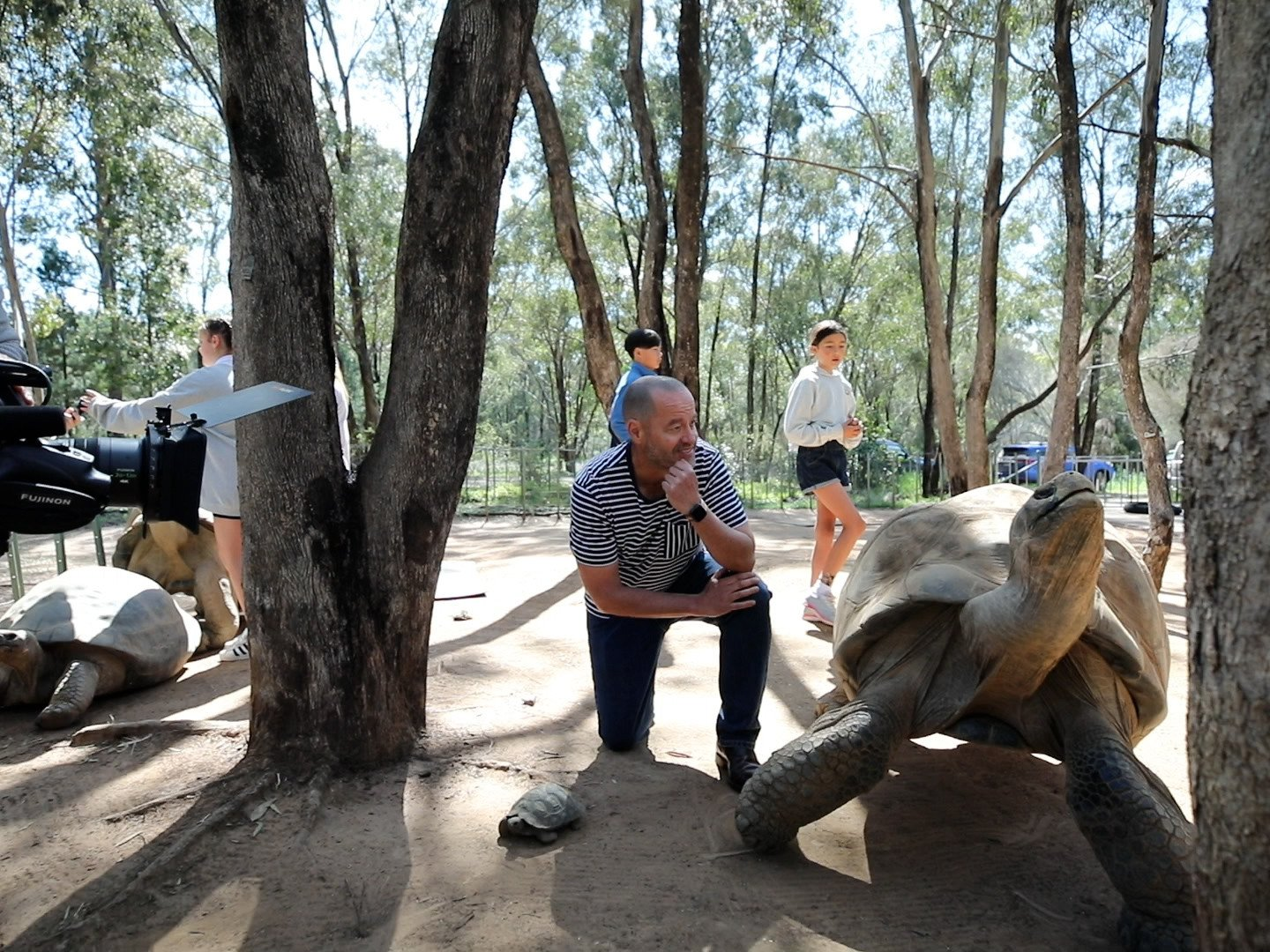 Adam Spencer behind the scenes with a Galapagos tortoise