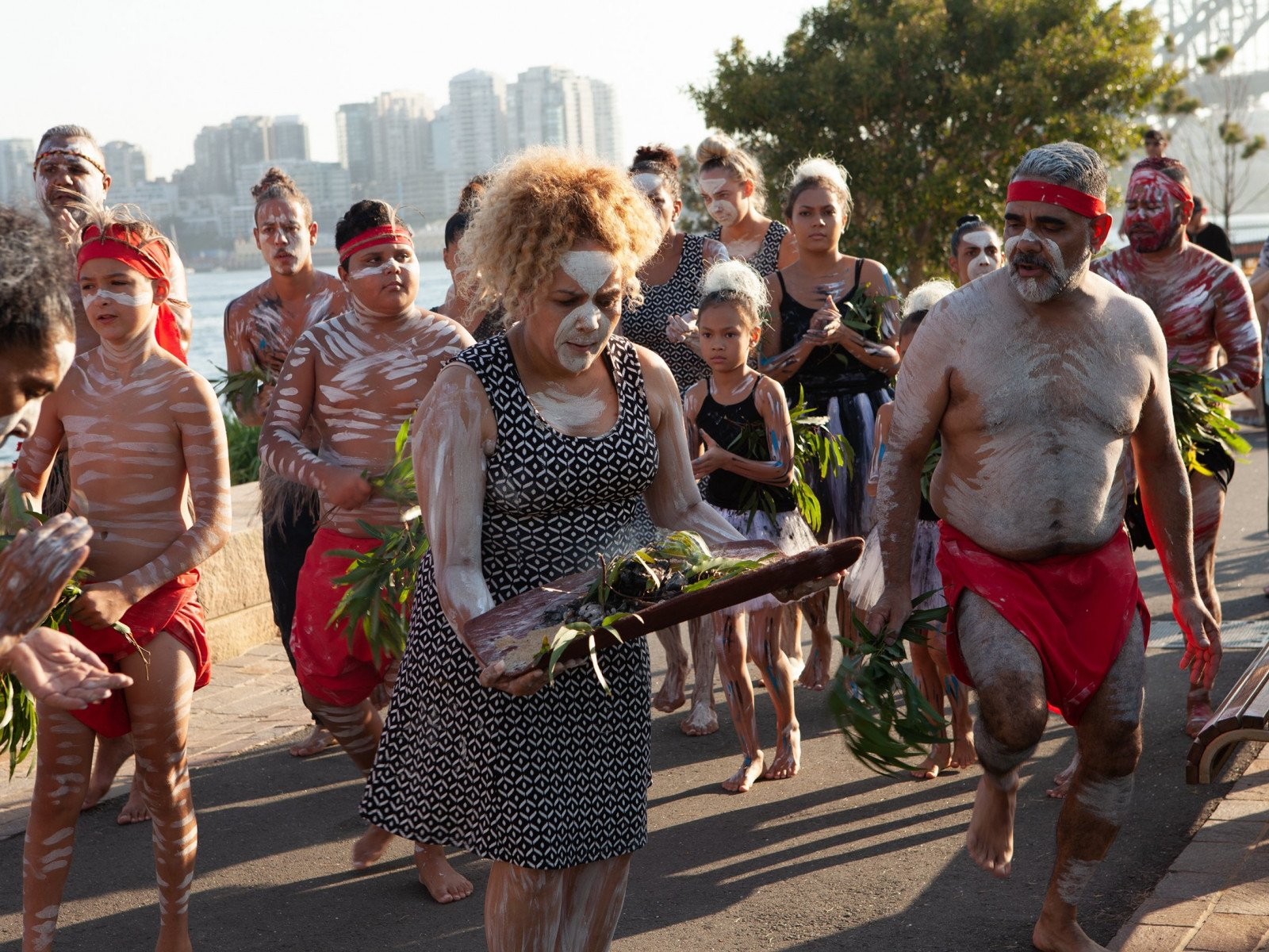 Transporting the fire from the foreshore to the lawns for the the Wugulora Indigenous Morning Ceremony